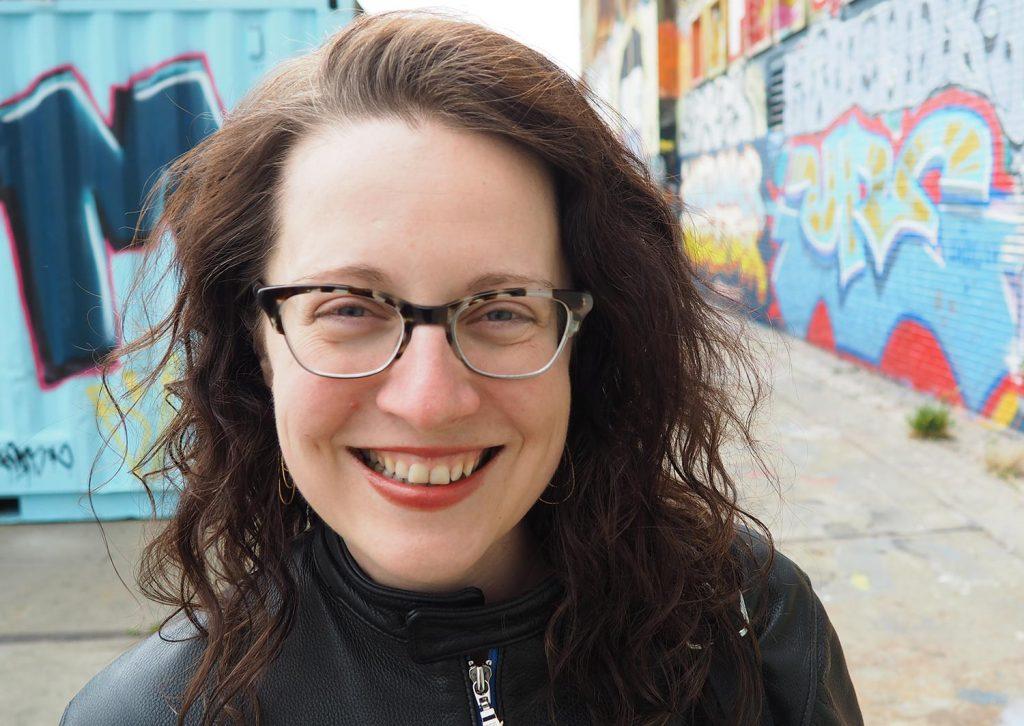 Elyzabeth Gorman Portrait with Graffitti'd NDSM in the background