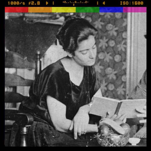 Black and white photo of Frida Belinfante reading