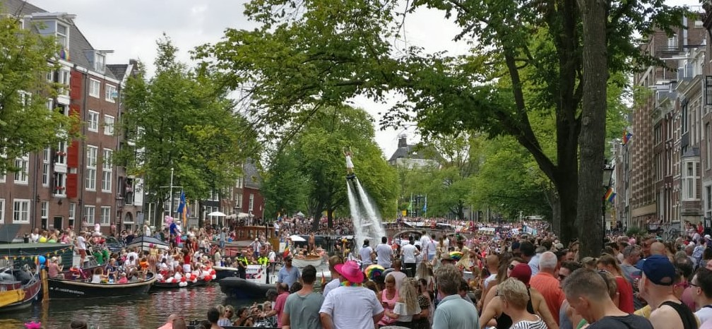 Crowded Prinsengracht during Amsterdam Pride